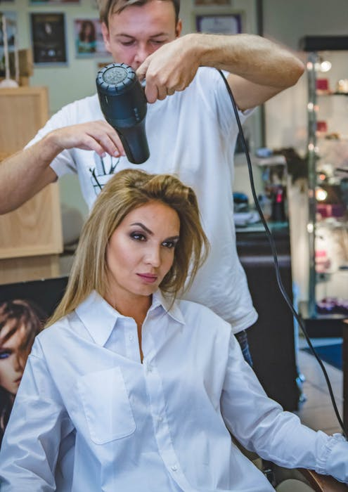 woman getting her hair blow dry