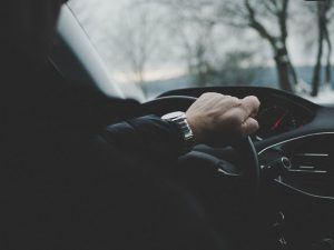 hand in the steering wheel while driving