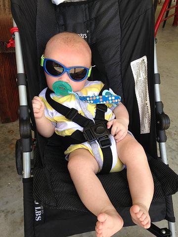 baby sitting in a baby pram