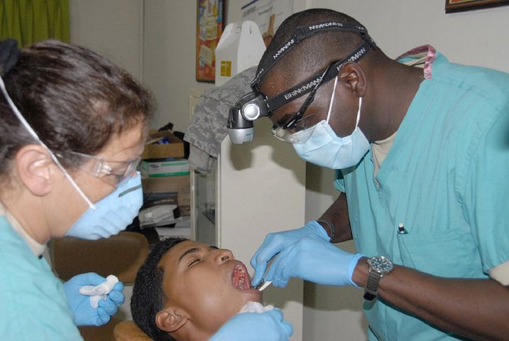 dentists in Lilydale attending to a patient