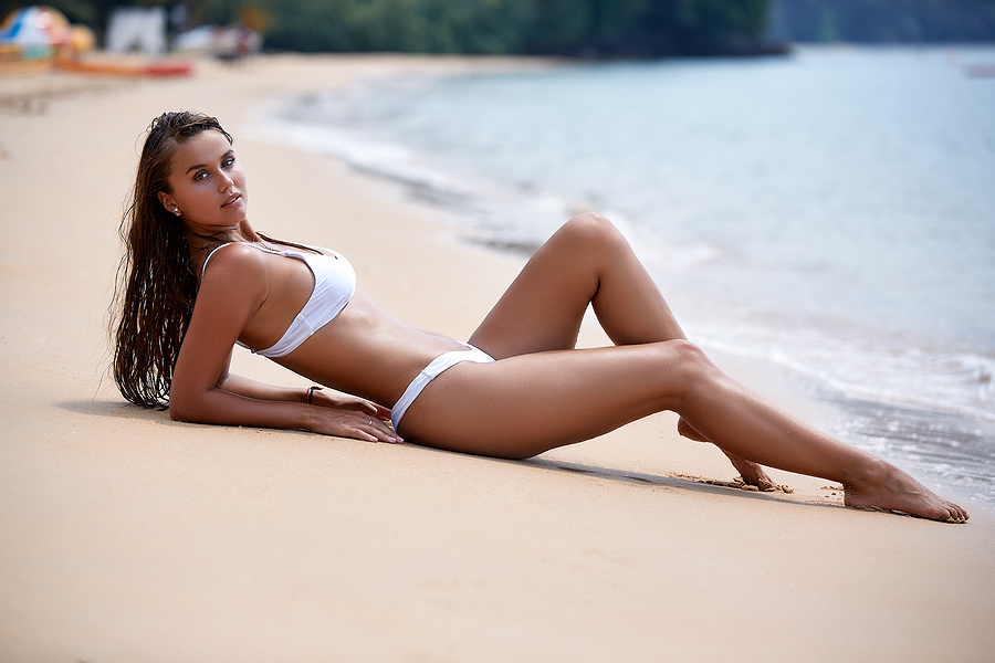 Beautiful woman flexing her white swimsuit from Myra Swim
