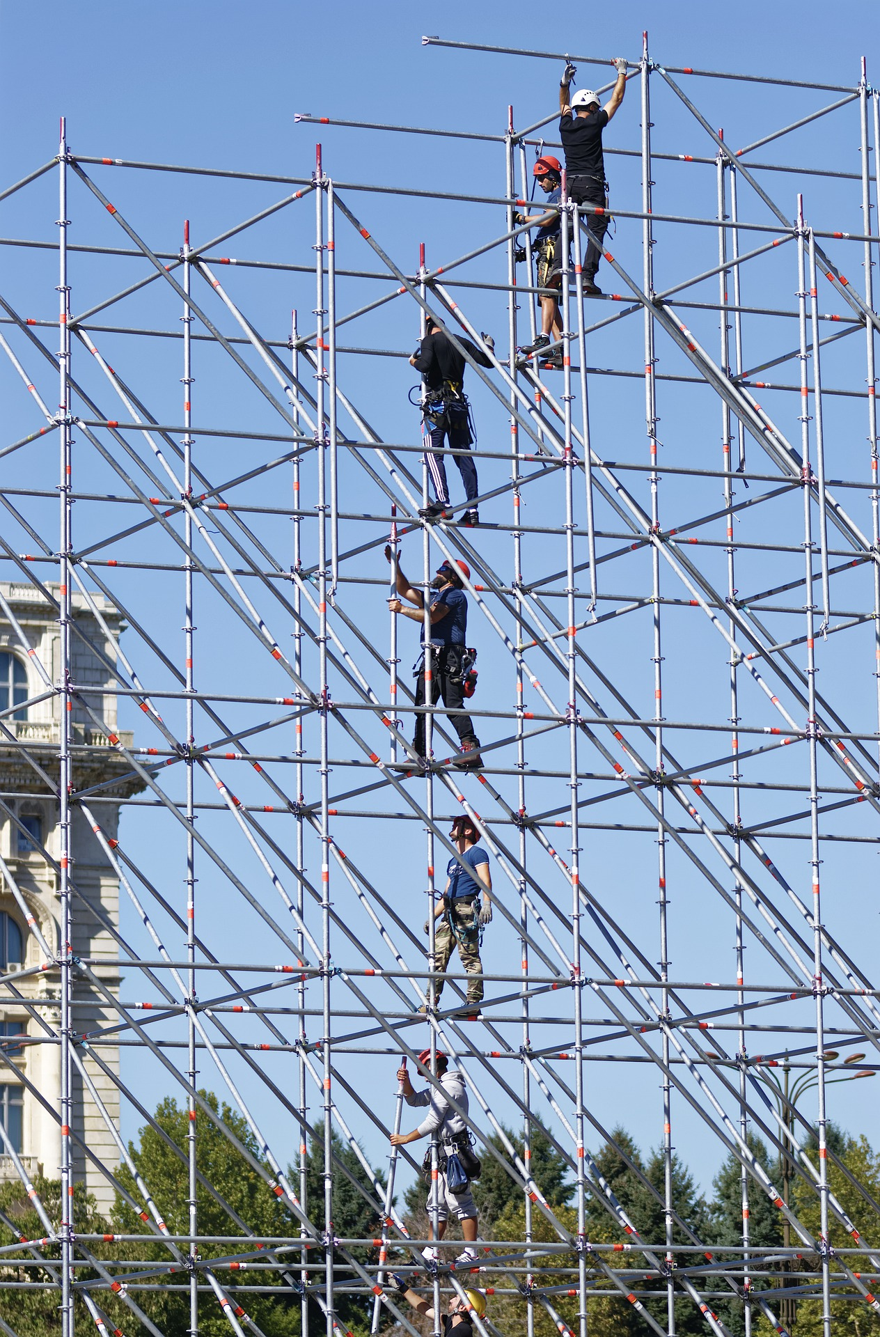 Workers standing in a scaffolding