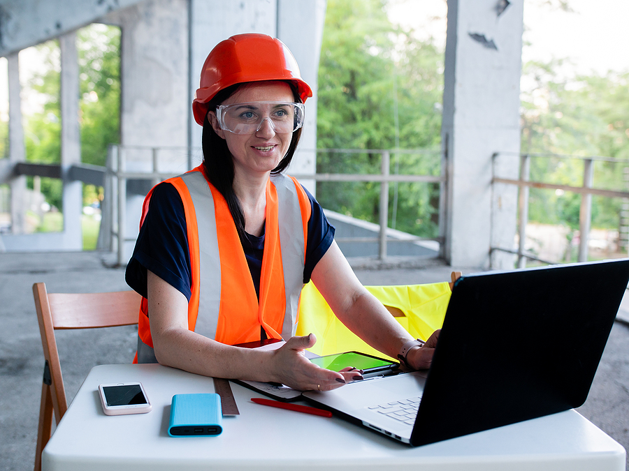 Woman using construction ERP software