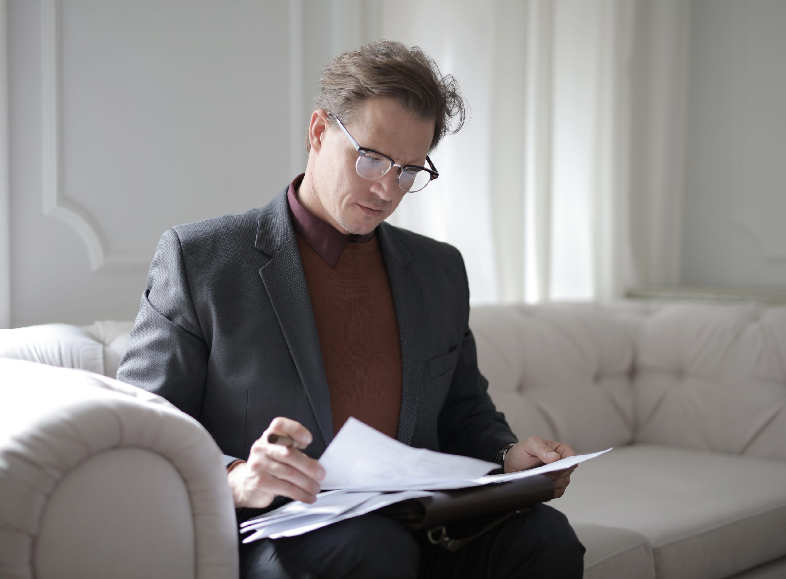 Divorce lawyer in Sydney looking over some papers